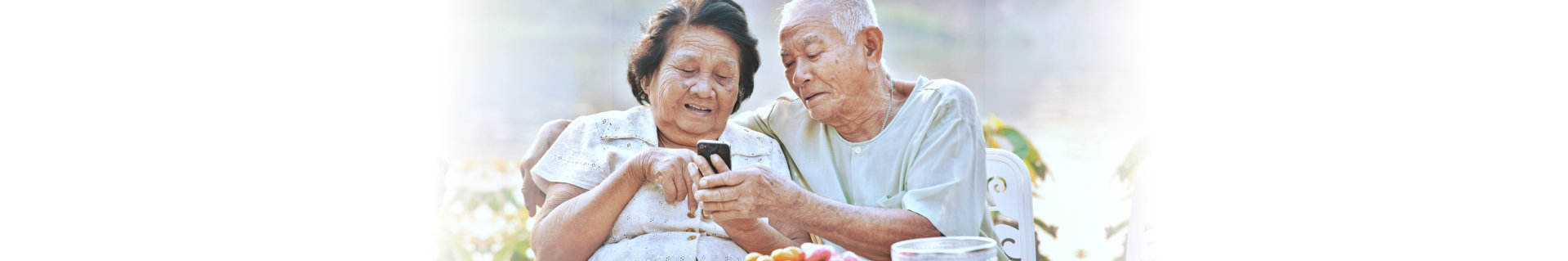 senior couple looking at a phone